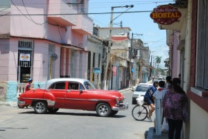 Holguin Street Scene with red classic car