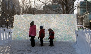 3 children in front of coloured ice wall at Winterlude 2017